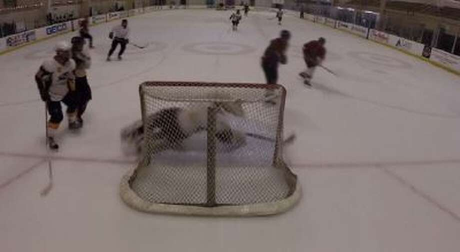 Patrick Heil goes across the crease to make a great save.