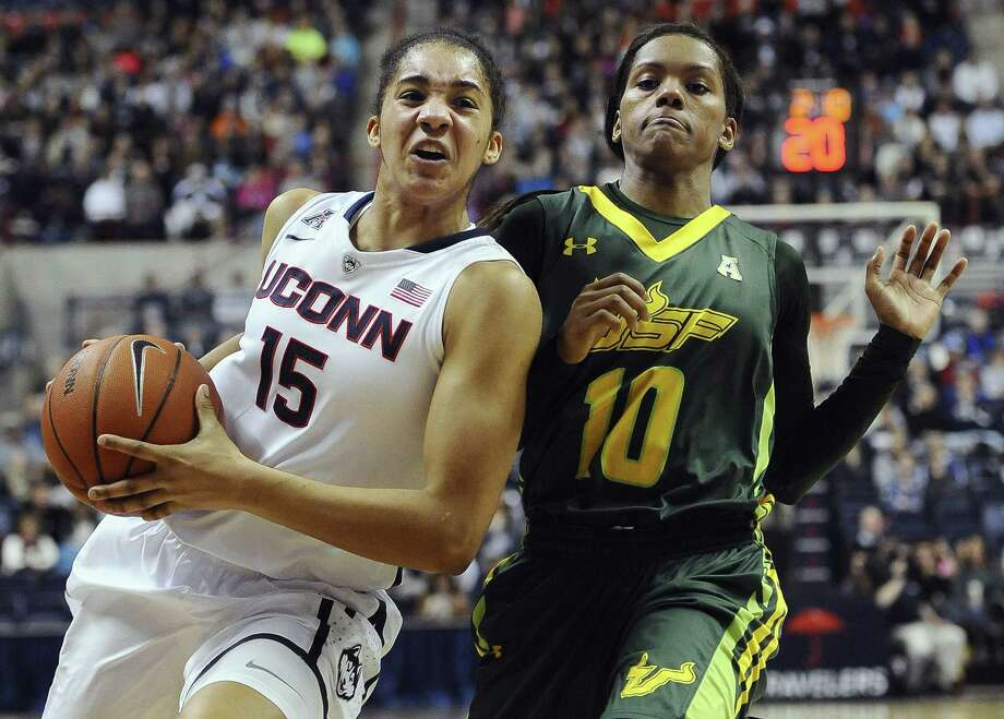 UConn's Gabby Williams, left, drives to the basket as South Florida's Courtney Williams defends during the first half Sunday in Storrs. Photo: Jessica Hill — The Associated Press  / FR125654 AP