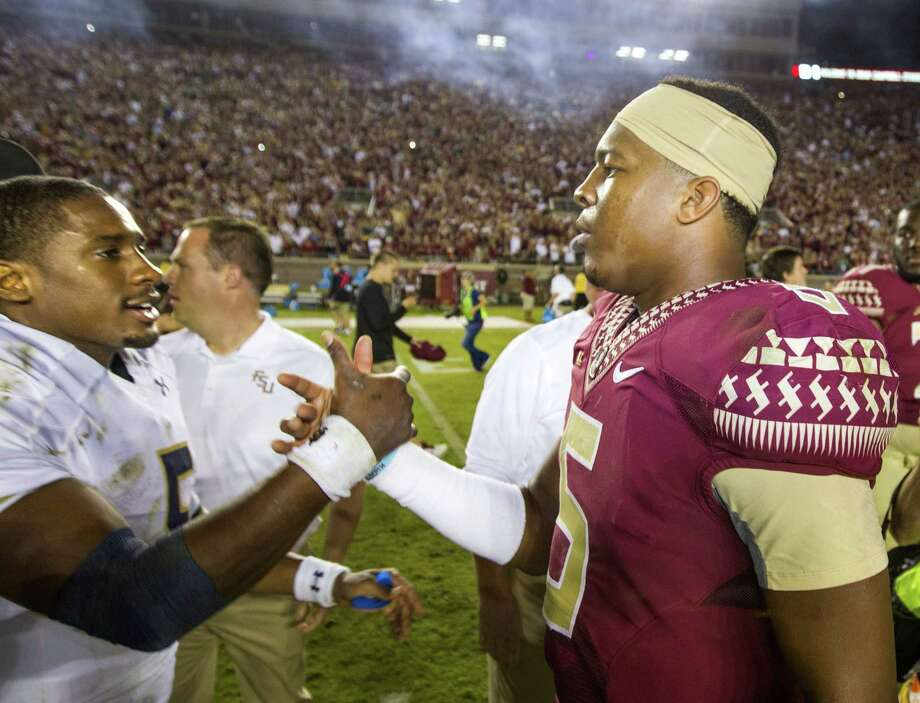 Former Notre Dame quarterback Everett Golson, left, says he is transferring to Florida State, where he will have the chance to replace Jameis Winston, right. Photo: Mark Wallheiser — The Associated Press File Photo  / FR171224 AP