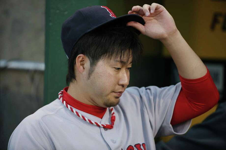 Red Sox reliever Junichi Tazawa stands in the dugout before Thursday's game. Photo: GenE J. Puskar — The Associated Press  / AP