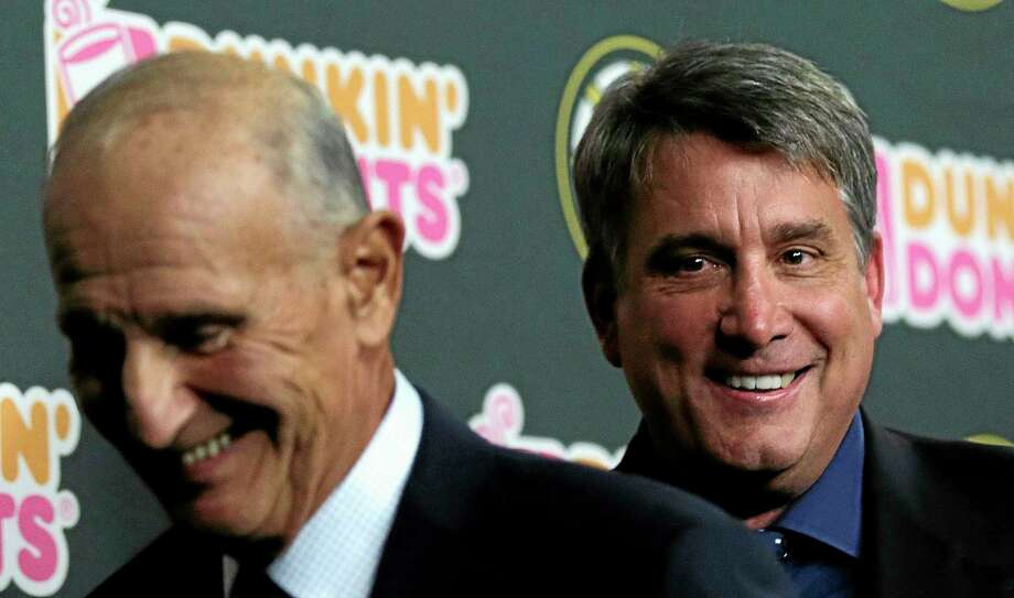 Boston Bruins president Cam Neely, right, smiles as he leaves with team owner Jeremy Jacobs after a news conference in Boston on Tuesday. Photo: Charles Krupa — The Associated Press  / AP