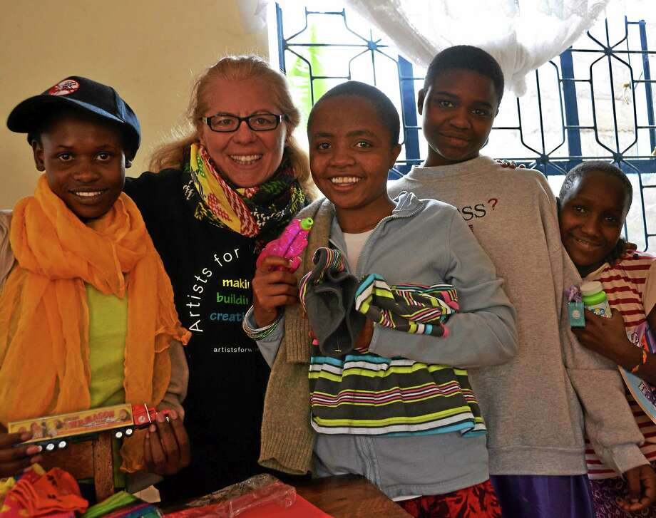 Wendy Black-Nasta of Middletown hugs children who live at the Good Hope Trust Orphanage. Photo: Courtesy Cynthia E. Rockwell