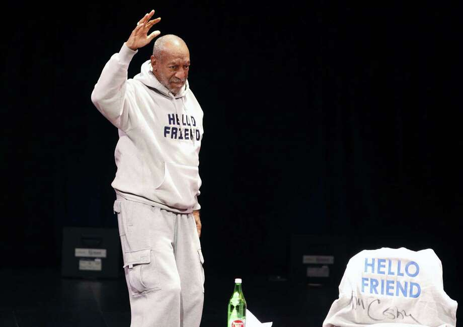 Comedian Bill Cosby waves as he walks onstage for a performance at the Buell Theater in Denver on Jan. 17, 2015. Photo: AP Photo/Brennan Linsley  / AP