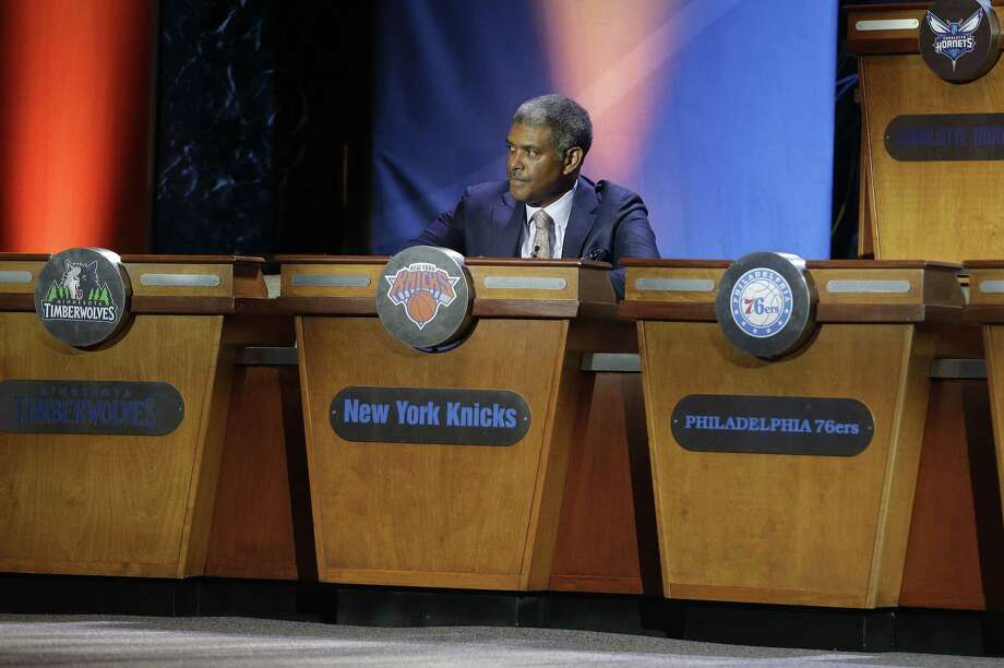 Knicks general manger Steve Mills listens as the top three NBA basketball draft positions are announced during the draft lottery on Tuesday. The Knicks dropped to the fourth position during the lottery. Photo: Julie Jacobson — The Associated Press  / AP