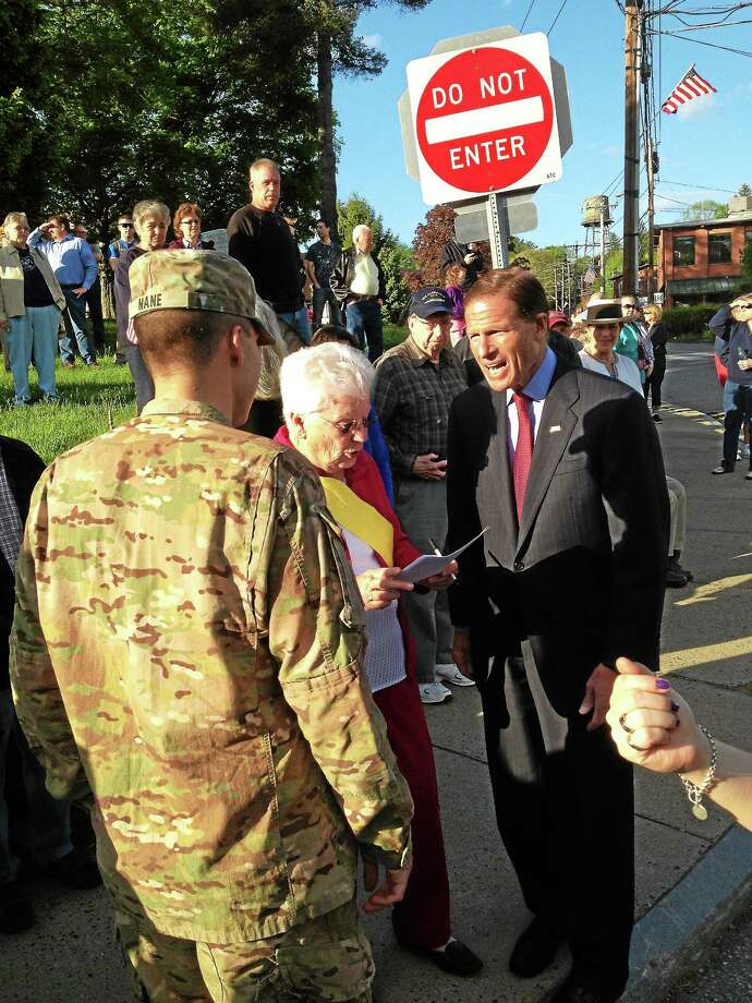 Jeff Mill - The Middletown Press Army 1st Lt. Sebastiano Nane returned East Hampton from Afghanistan Monday with U.S. Sen. Richard Blumenthal greeting him. Photo: Journal Register Co.