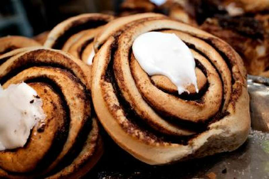 Cinnamon rolls are displayed at a bakery in Copenhagen, Denmark.