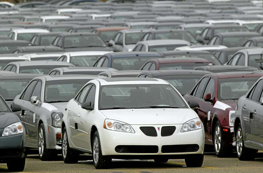 FILE - This March 16, 2006 file photo shows a Pontiac G6  shown outside the General Motors Orion Assembly plant in Orion Township, Mich. General Motors is recalling 2.4 million vehicles in the U.S., including Pontiac G6's from the 2005-2008 model years, as part of a broader effort to resolve outstanding safety issues more quickly.  (AP Photo/Paul Sancya, File) Photo: AP / AP