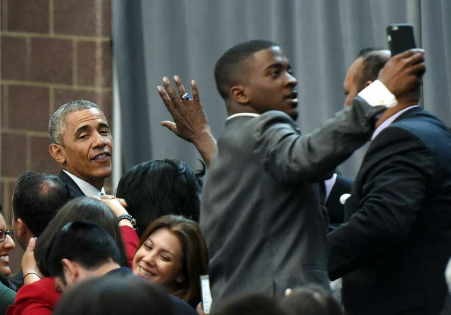 A young man elevates above the crowd trying to take a selfie with President Obama at Ray and Joan Kroc Corps Community Center during his visit to Camden, N.J. on Monday, May 18, 2015. Obama also visited with local law enforcement and youth in the community. On Monday, President Obama also banned the federal government from providing some military-style equipment to local police departments and put much stricter controls on others. Photo: The Record Via AP  / Northjersey.com