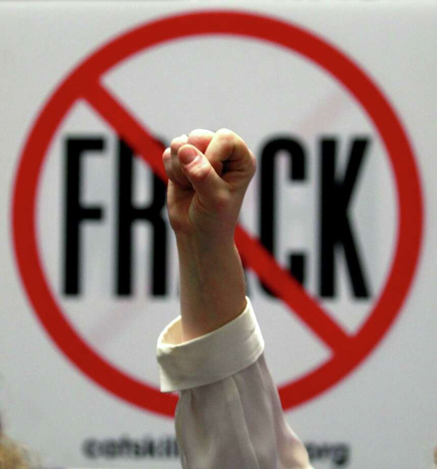 Gillie Waddington of Enfield, N.Y., raises a fist during rally against hydraulic fracturing of natural gas wells at the Legislative Office Building in Albany, N.Y., in this 2012 file photo. Photo: AP File Photo  / AP