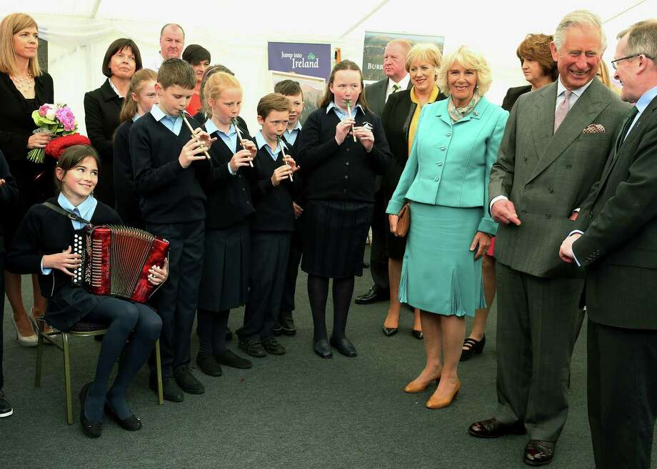 Britain's Prince  Charles, second right,  along with Camilla Duchess of Cornwall, third right,  listen to musical performance by school children at a welcome reception in Galway Ireland on the first day of their Royal visit to the Republic of Ireland Tuesday May 19, 2015.  Prince Charles has begun an official visit to Ireland featuring two new milestones of peacemaking: his first meeting with leaders of the Irish nationalist Sinn Fein party, and his first trip to the fishing village where the Irish Republican Army killed his great-uncle 36 years ago. It is Charlesí third trip to the Irish Republic since the outlawed IRA called a 1994 cease-fire. (Brian Lawless/Pool Photo via AP) Photo: AP / POOL PA