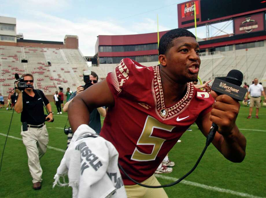 Florida State quarterback Jameis Winston made lewd comments recently on campus and has been benched for the first half of Saturday's game against Clemson. Photo: Phil Sears — The Associated Press File Photo  / FR170567 AP