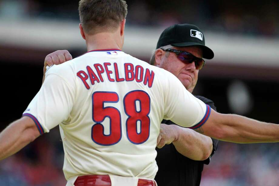 Phillies pitcher Jonathan Papelbon argues with umpire Joe West after being ejected Sunday against the Miami Marlins in Philadelphia. Photo: H. Rumph Jr. — The Associated Press  / FR61717 AP