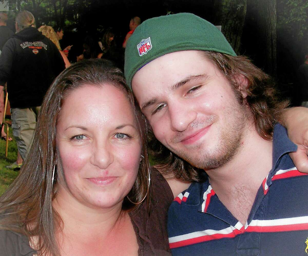 This 2012 photo shows Margaret Rohner, left, with her son Bobby Rankin, 23. The day after Christmas 2013, Rohner, 45, was viciously attacked with a fireplace poker, and her body left in the living room of her Deep River, home.