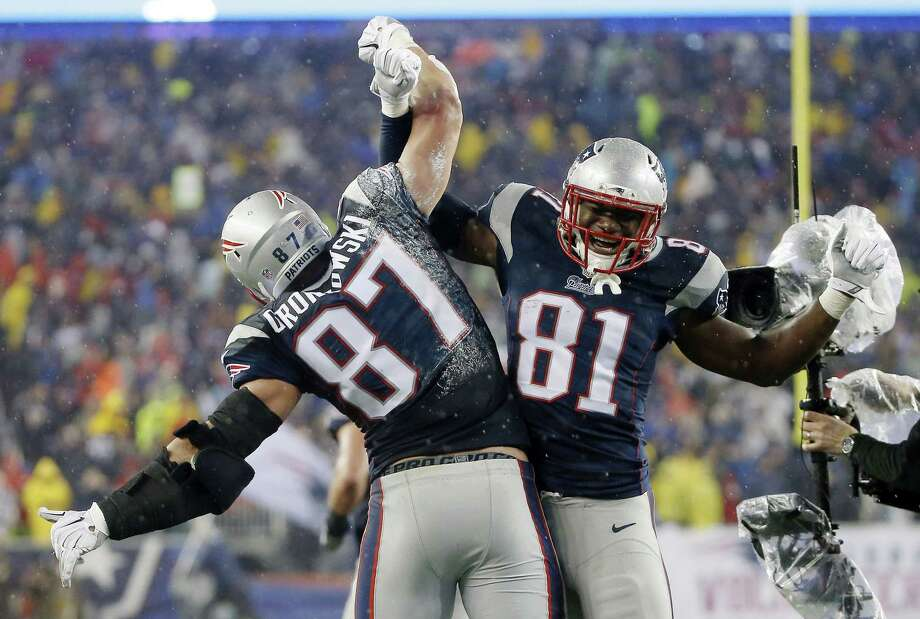 Patriots tight end Rob Gronkowski (87) celebrates with teammate Tim Wright after his five-yard touchdown catch during the second half Sunday. Photo: Elise Amendola — The Associated Press  / AP