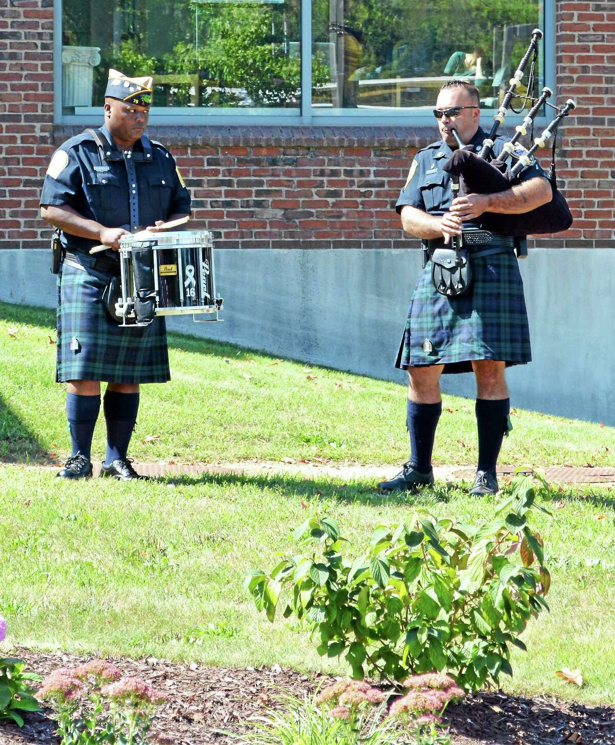 Bagpipers were part of the short ceremony at Middlesex Community College this week.