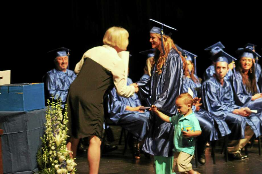 A young mother, with child in tow, graduates in 2014 from the Middletown Adult Education program. This year's ceremony is May 27 at Middletown High School. Photo: Courtesy Photo