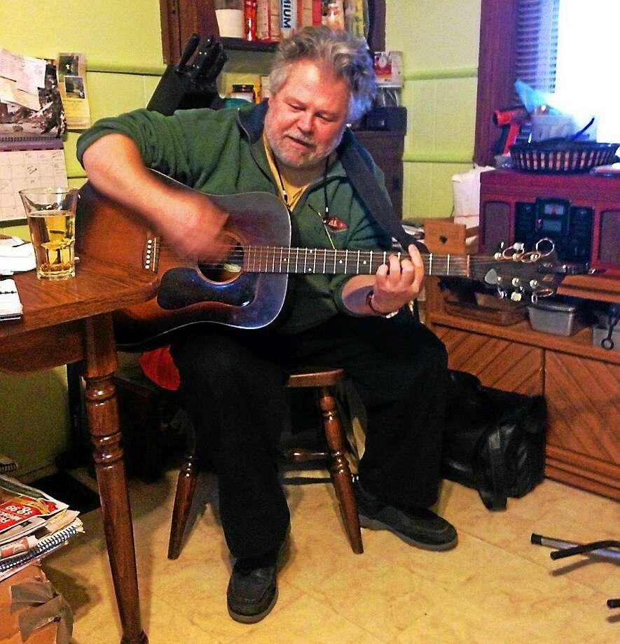 """Singer-songwriter Dave Downs of Middletown performs solo and as part of a duo called the Rust'd Keys, which plays """"noveau croon,"""" original music from the 1930 and '40s. Photo: Christopher Pace — Special To The Press"""