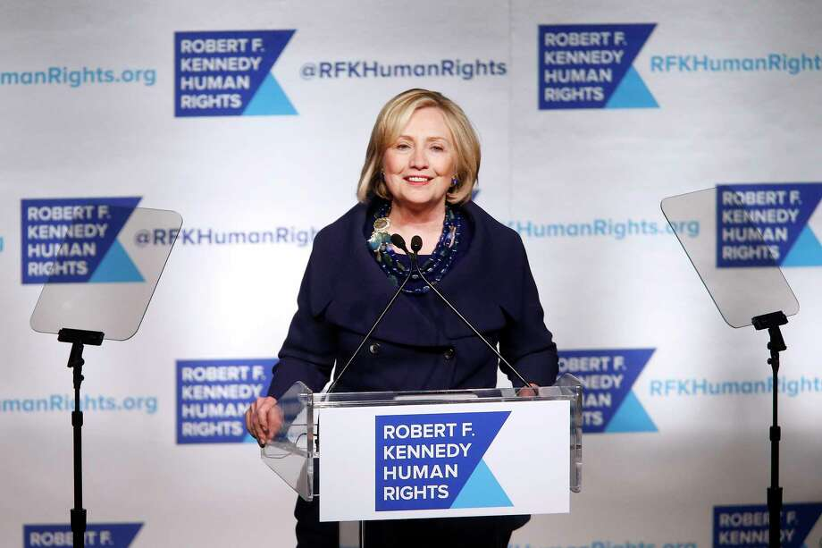 Former Secretary of State Hillary Rodham Clinton speaks after accepting the Robert F. Kennedy Ripple of Hope Award during a ceremony on Dec. 16, 2014 in New York. Photo: AP Photo/Jason DeCrow  / FR103966 AP