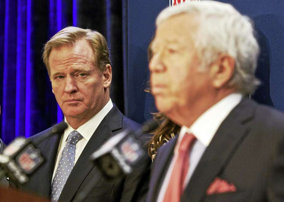 NFL commissioner Roger Goodell, left, looks on as New England Patriots owner Robert Kraft speaks at an NFL press conference last year. Photo: The Associated Press File Photo  / FR168019 AP