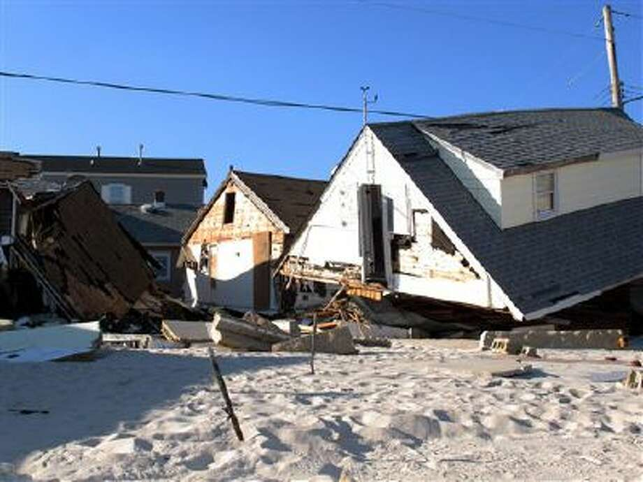 This Nov. 29, 2012, photo shows the wreckage of an oceanfront neighborhood in Toms River, N.J., one month after Superstorm Sandy pummeled it. Photo: AP / AP