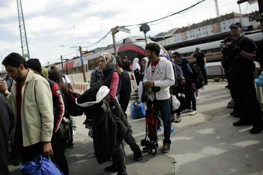 Refugees arrive at the train station of the southern German border town Passau on Sept. 15, 2015 after they have been taken off a train by German border police for registration. Photo: AP Photo/Markus Schreiber  / AP