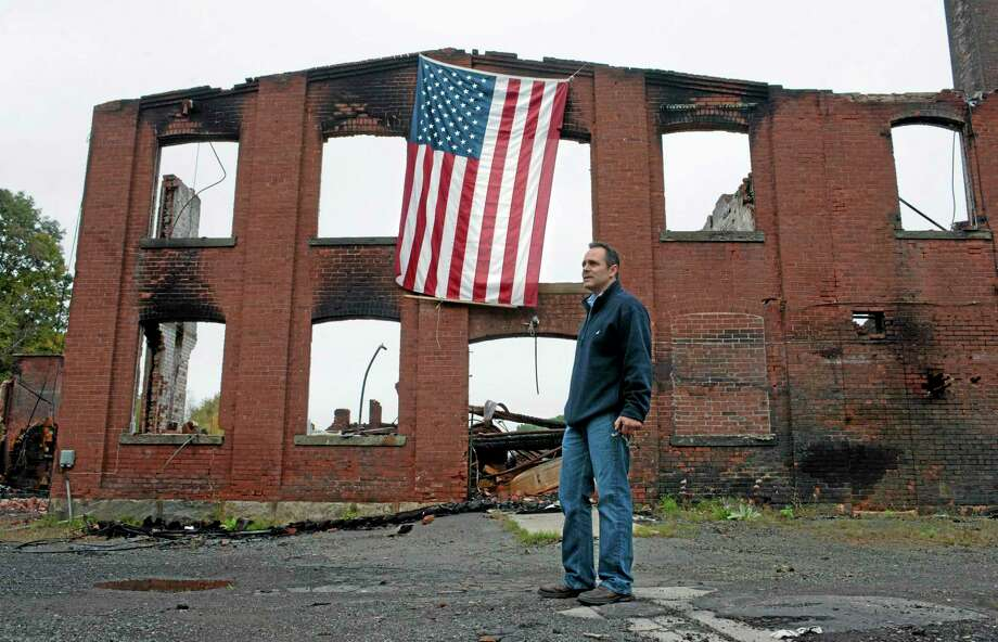 Matt Bevin stands at the site of his family's factory destroyed by fire in East Hampton on Wednesday, Oct. 3, 2012.  (AP Photo/Jessica Hill) Photo: AP / FR125654 AP