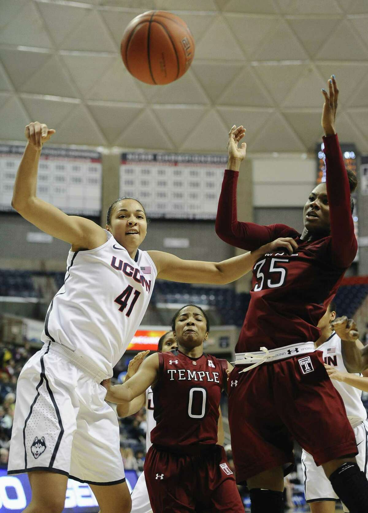 UConn's Kiah Stokes fights for a rebound against Temple's Alliya Butts (0) and Safiya Martin during the Huskies' 92-58 win on Wednesday in Storrs.