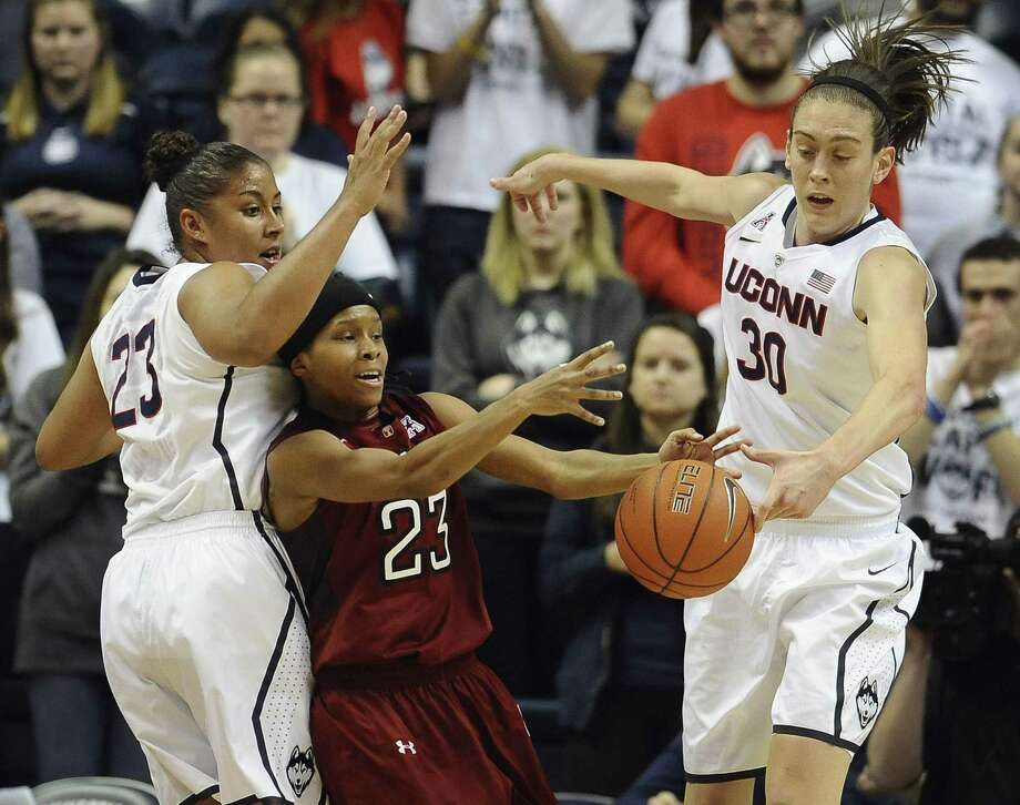 UConn's Kaleena Mosqueda-Lewis, left, and Breanna Stewart pressure Temple's Tyonna Williams during the Huskies' 92-58 win Wednesday in Storrs. Photo: Jessica Hill — The Associated Press  / FR125654 AP