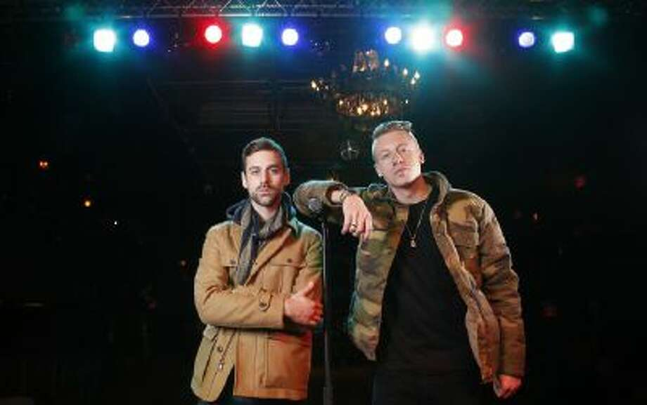In this Tuesday, Nov. 20, 2012 file photo, American musician Ben Haggerty, better known by his stage name Macklemore, right, and his producer Ryan Lewis pose for a portrait, at Irving Plaza in New York. Macklemore & Ryan Lewis have seven nominations at Sunday, Jan. 26, 2014 Grammys, including best new artist, album of the year for ?The Heist? and song of the year for ?Same Love.?