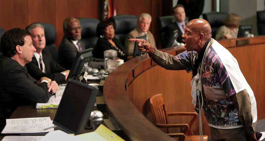 St. Louis activist Anthony Shahid confronts councilman Steve Stenger during the St. Louis County Council on Tuesday, Sept. 16, 2014, in Clayton, Mo. Protesters seeking the immediate arrest of Ferguson police officer Darren Wilson who fatally shot unarmed 18-year-old Michael Brown disrupted a government meeting Tuesday, renewing calls to remove the county prosecutor investigating the case. Photo: (AP Photo/St. Louis Post-Dispatch, Robert Cohen)    / St. Louis Post-Dispatch