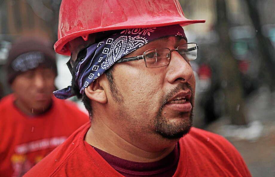 Day laborer Martin Garcia, a day laborer from Mexico, takes a break from a carpentry job. Photo: AP Photo/Bebeto Matthews  / AP