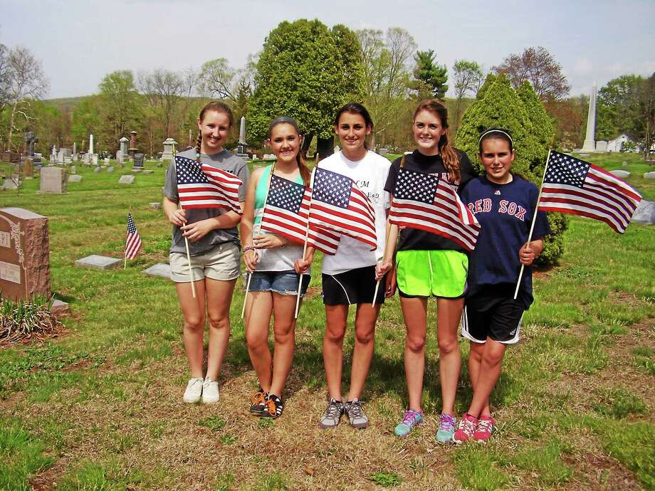 Submitted photo Five Portland Key Club members volunteered their time on May 10 to go help veterans place flags at the St. Mary, the Trinity, the Swedish and Center cemeteries. Photo: Journal Register Co.
