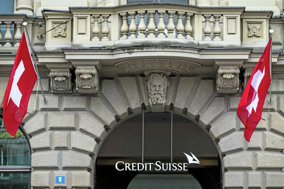 In this April 27, 2014, file picture, Swiss flags fly at the entrance of of Swiss bank Credit Suisse in Zurich, Switzerland. European bank Credit Suisse AG pleaded guilty to helping wealthy Americans avoid paying taxes through secret offshore accounts and agreed to pay about $2.6 billion. Photo: Ap File Photo  / KEYSTONE