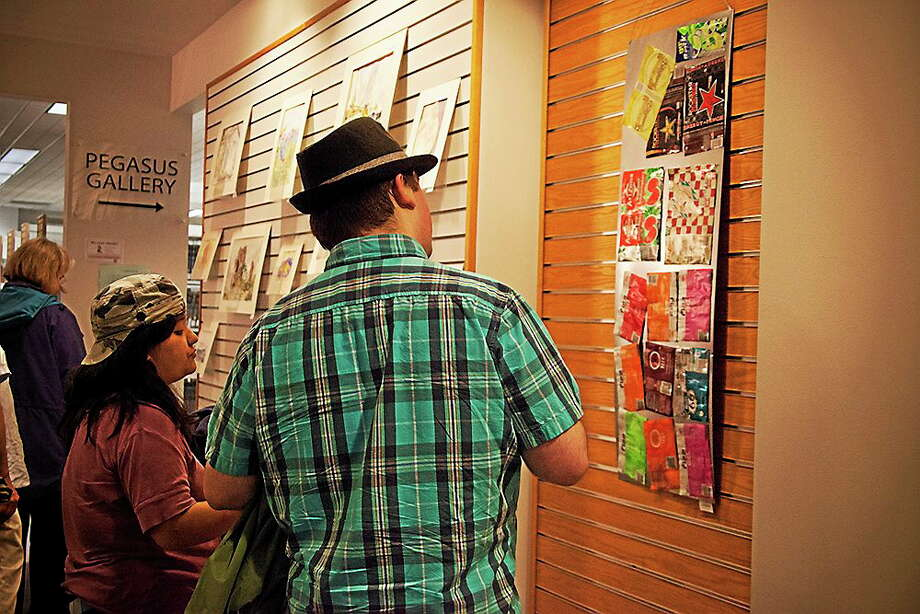 A student views artwork from last year's Arts and Media Festival at Middlesex Community College. Photo: Submitted Photo