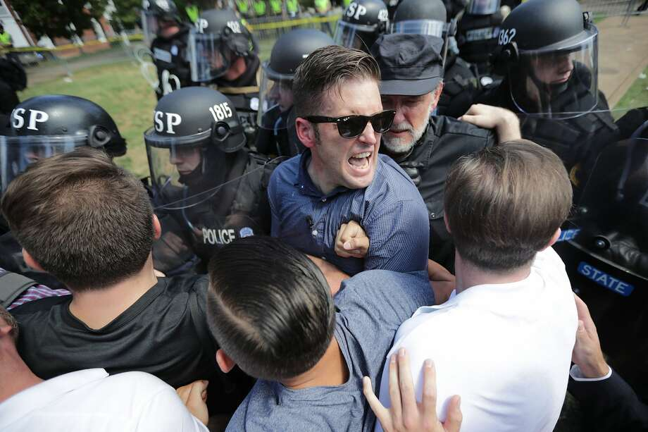 "White nationalist Richard Spencer, center, and his supporters clash with Virginia State Police in Lee Park after the ""Unite the Right"" rally was declared an unlawful gathering August 12, 2017 in Charlottesville, Virginia. Hundreds of white nationalists, neo-Nazis and members of the ""alt-right"" clashed with anti-fascist protesters and police as they attempted to hold a rally in Lee Park, where a statue of Confederate General Robert E. Lee is slated to be removed. (Photo by Chip Somodevilla/Getty Images) Photo: Chip Somodevilla/Getty Images"