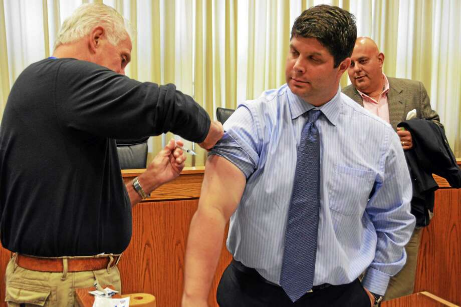 Middletown Mayor Dan Drew gets his annual flu shot at city hall Tuesday. Clinics begin soon. Photo: Brian Zahn — The Middletown Press