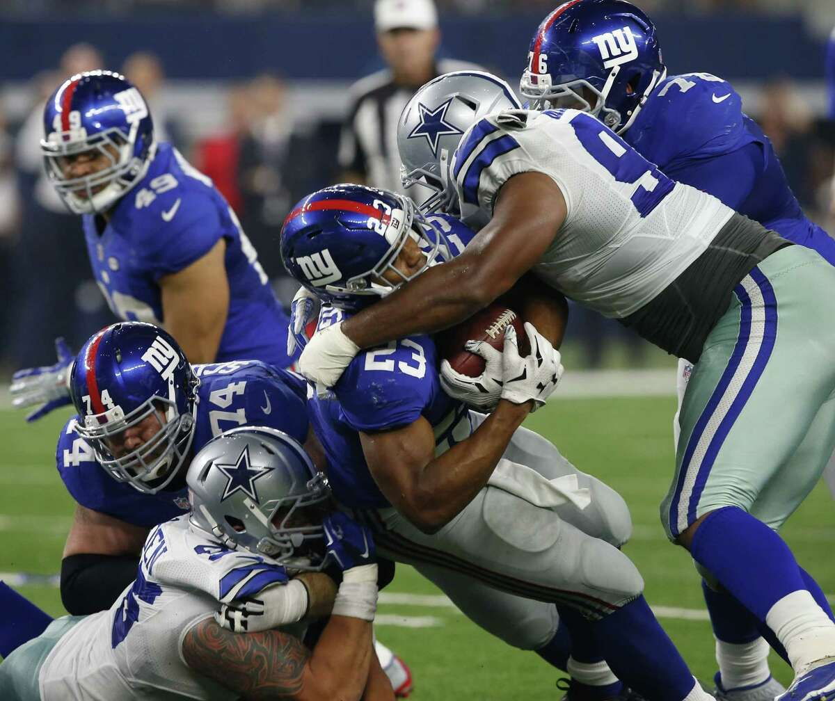 Giants running back Rashad Jennings (23) is tackled by Cowboys defensive tackle Nick Hayden.