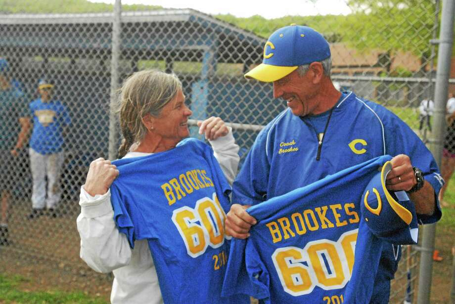 H-K baseball coach Mark Brookes and his wife, Rae, celebrate after the Cougars' 4-0 win over Morgan Sunday at Higganum. It was Brookes' 600th career win. Photo: Jimmy Zanor — Middletown Press