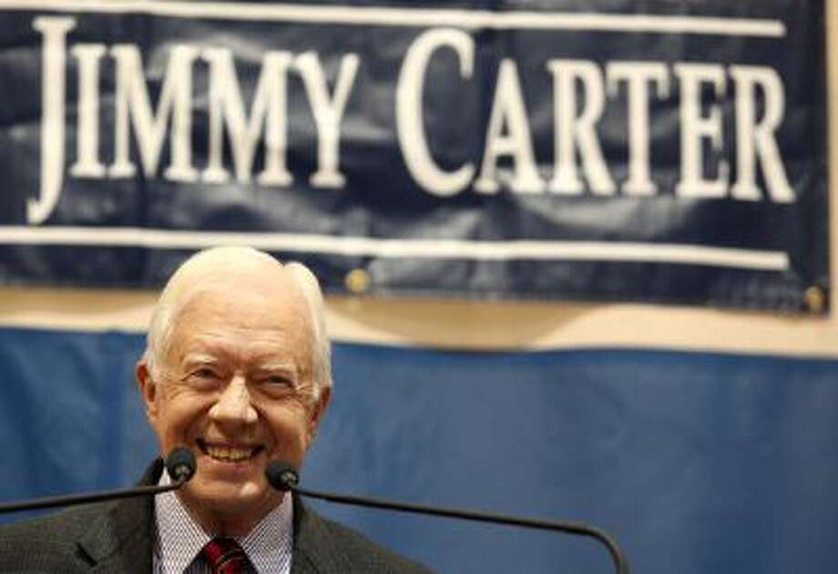 ATLANTA - SEPTEMBER 16: Former President Jimmy Carter smiles at the crowd during his 28th annual town hall meeting at Emory University on September 16, 2009 in Atlanta, Georgia. Carter answered Emory students' questions ranging in topics from racism, health care and the Middle East during the one-hour town hall meeting. (Photo by Jessica McGowan/Getty Images) Photo: Getty Images / 2009 Getty Images