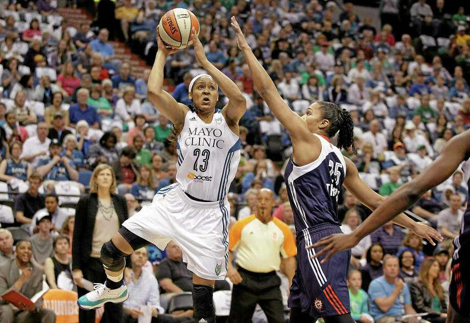 Minnesota Lynx forward Maya Moore (23) looks to shoot the ball against Connecticut Sun forward Alyssa Thomas (25) in the first half Sunday. Photo: Stacy Bengs — The Associated Press  / FR170489 AP