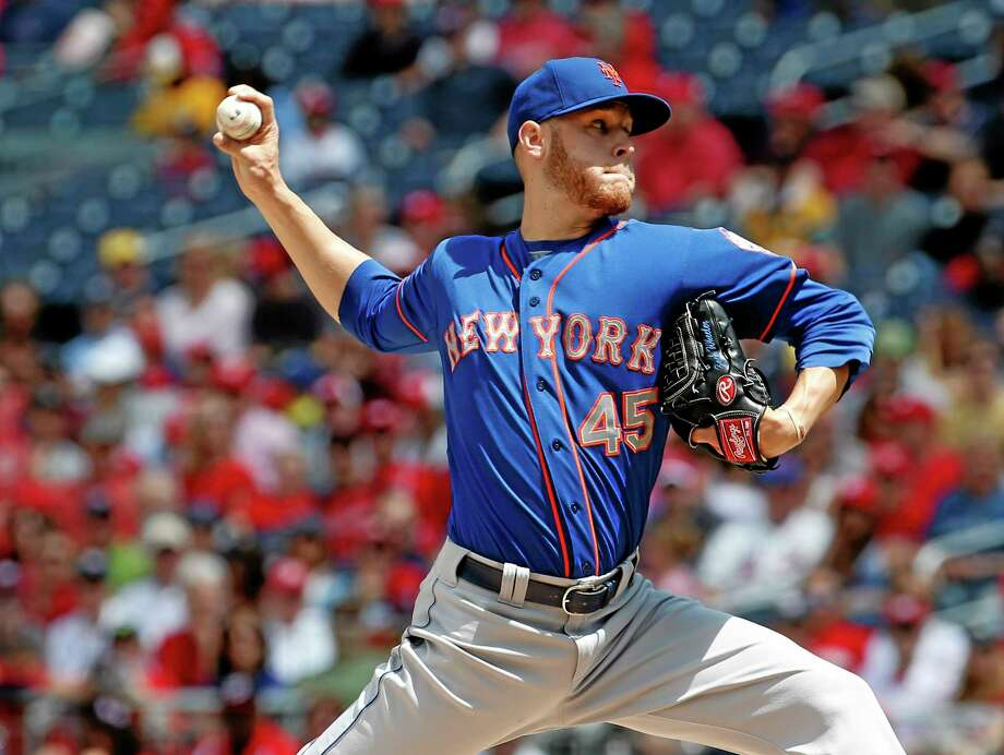 New York Mets starting pitcher Zack Wheeler throws during the third inning Sunday. Photo: Alex Brandon — The Associated Press  / AP