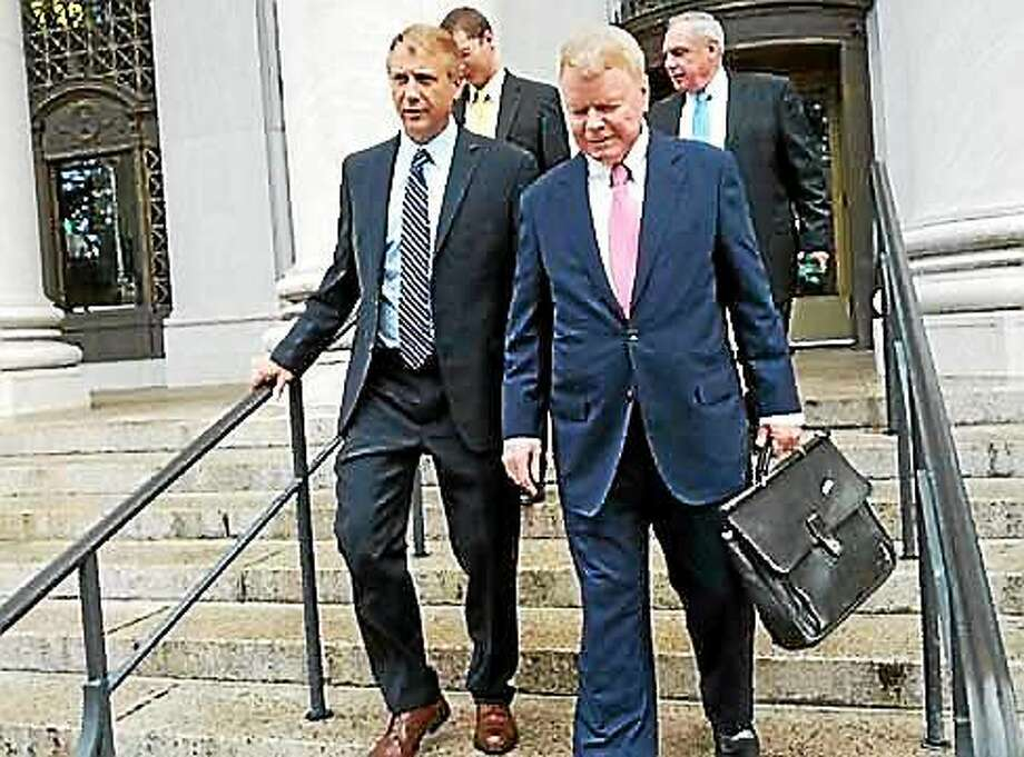 Apple Rehab executive Brian Bedard, left, and his attorney, Hugh Keefe, leave the federal courthouse in New Haven on Tuesday. Photo: Hugh McQuaid — CTNewsJunkie.com