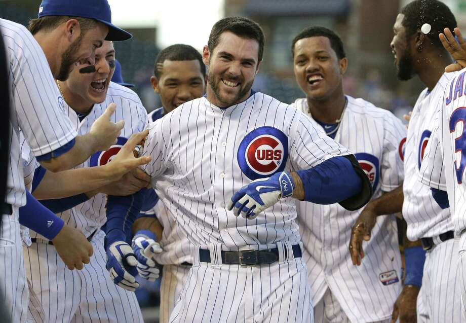 The Cubs' Matt Szczur, center, celebrates with teammates after hitting the game-winning single during the 12th inning of Friday's game against the Pittsburgh Pirates in Chicago. Photo: Nam Y. Huh — The Associated Press  / AP