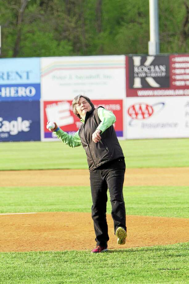 Courtesy De Kine Photo Chamber Chairwoman Darlene Briggs throws out the ceremonial first pitch at the New Britain Rock Cats game May 15. Photo: Journal Register Co. / (c)dekinephotoLLC2013