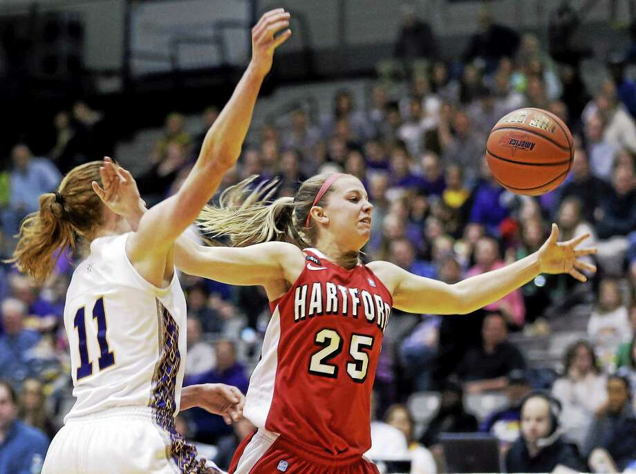 Hartford guard Amber Bepko, a Guilford native and former Mercy star, battles with Albany's Julie Forster during the 2013 America East tournament championship game. Photo: Mike Groll — The Associated Press File Photo  / AP