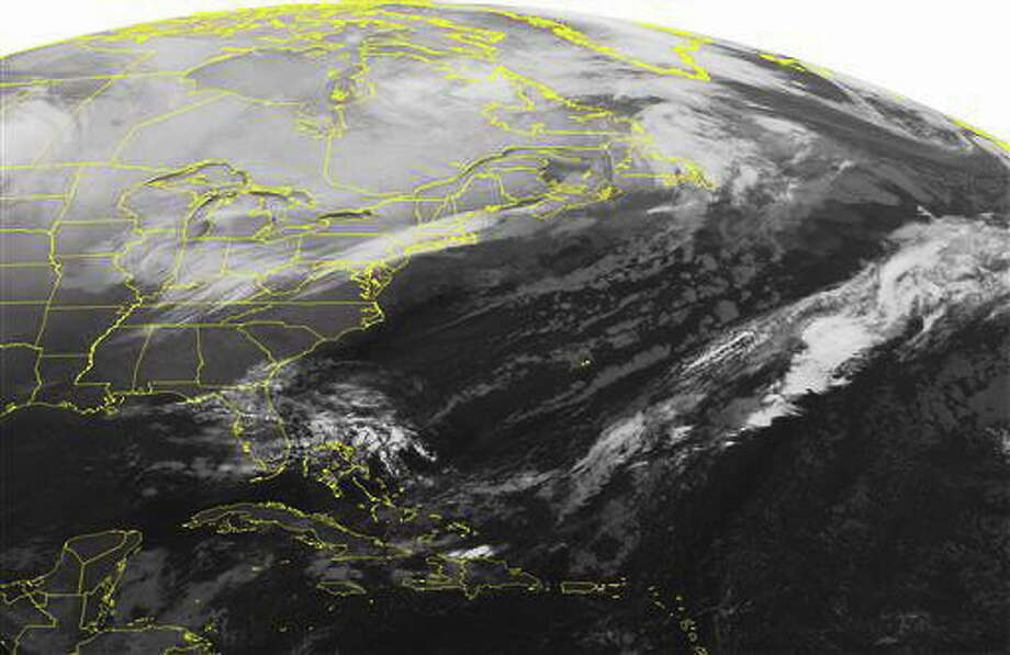 This NOAA satellite image taken Tuesday, Jan. 21, 2014, at 01:45 AM EST shows a developing storm over the Ohio Valley. Along with a cold front that is coming off the coast of New England. A batch of cloudiness is developing over Florida with a disturbance moving through that area. (AP Photo/Weather Underground) Photo: AP / Weather Underground