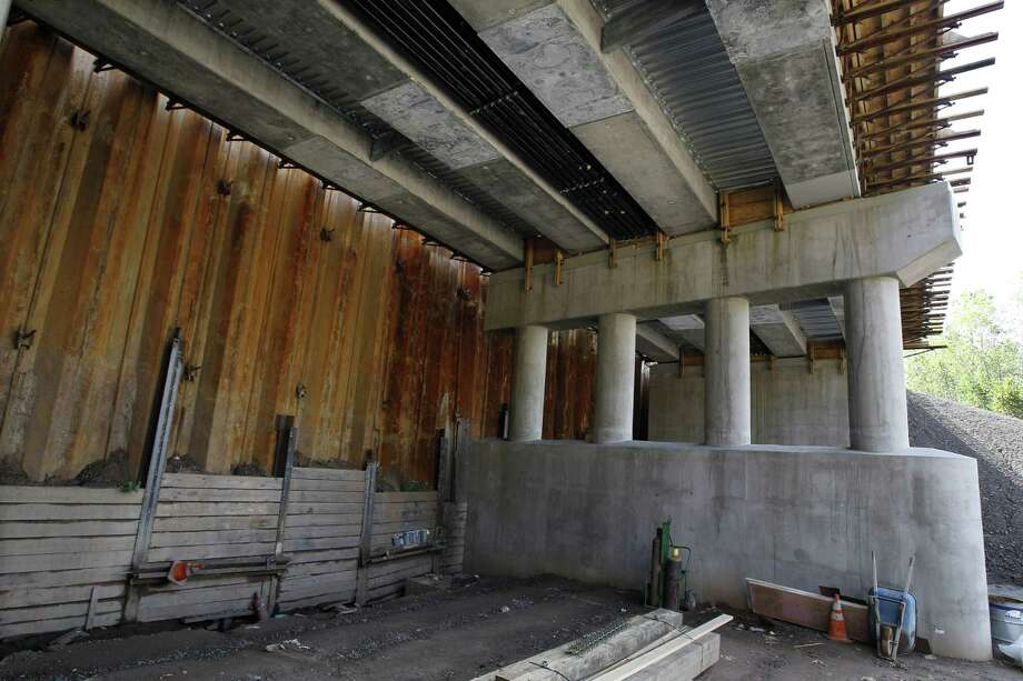 FILE - This Oct. 19, 2010 file photo shows a large, rusty metal wall covering construction at the ARC Tunnel in North Bergen, N.J. Officials had a plan funded to relieve chronic backups between New York and New Jersey by building two more tubes in a second tunnel, but New Jersey Gov. Chris Christie pulled the plug, citing concerns about his state's share of the project's massive cost. (AP Photo/Mel Evans) Photo: AP / AP