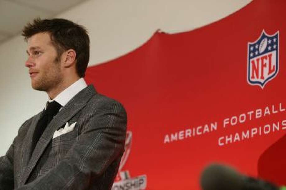 New England Patriots quarterback Tom Brady responds to questions during news conference after his team's 26-16 loss to the Denver Broncos.