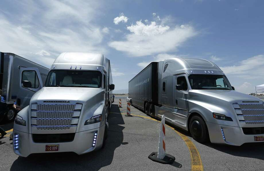 People load in to a Daimler Freightliner Inspiration self-driving truck for a demonstration this month in Las Vegas. Photo: John Locher — The Associated Press  / AP