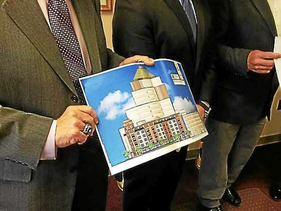 Mayor Daniel Drew (center) announced a plan for a six-story apartment tower adjacent to the MiddleOak building in Middletown. Photo: File Photo